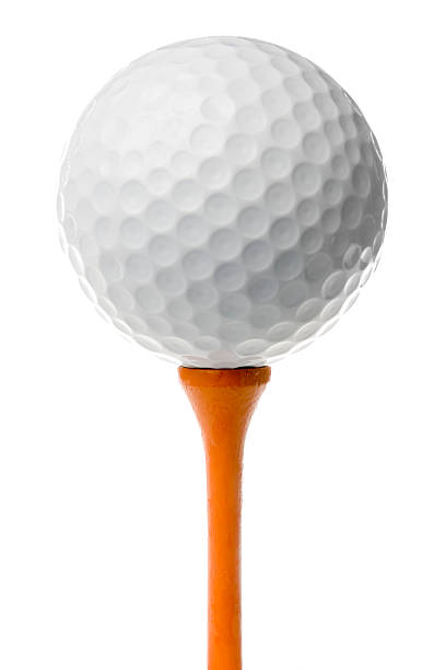 "Golf ball on orange tee ""White golf ball stands on tall, wooden orange tee. Isolated on white."" golf ball stock pictures, royalty-free photos & images"