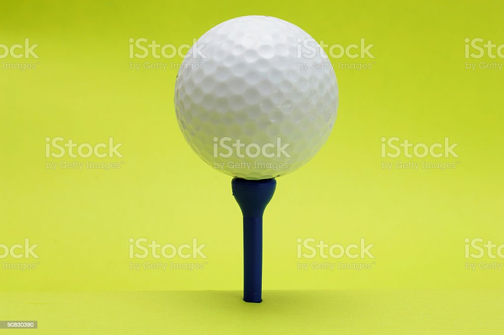 golf ball on tee against off green royalty-free stock photo