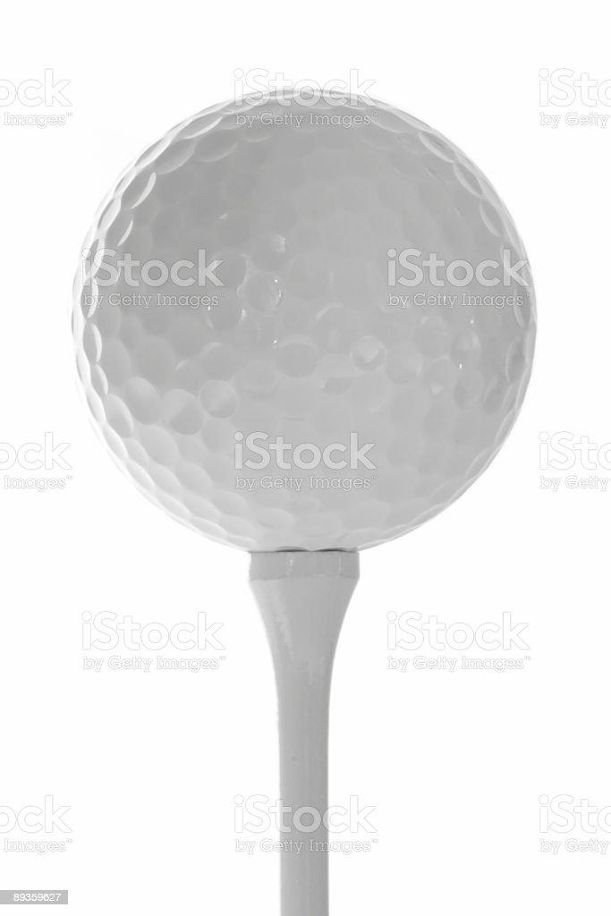 Golf Ball on Tee against White Background royaltyfri bildbanksbilder