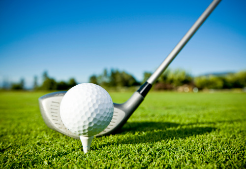 Golf Ball On Tee And Golf Club On Golf Course Stock Photo - Download Image Now