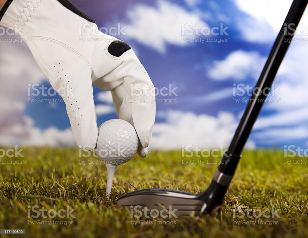 Golf ball on tee in driver royalty-free stock photo