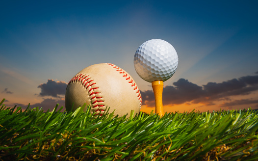 istock golf ball on tee pegs ready to play baseball on the green lawn at sunset with clouds in the evening day background 1182768634