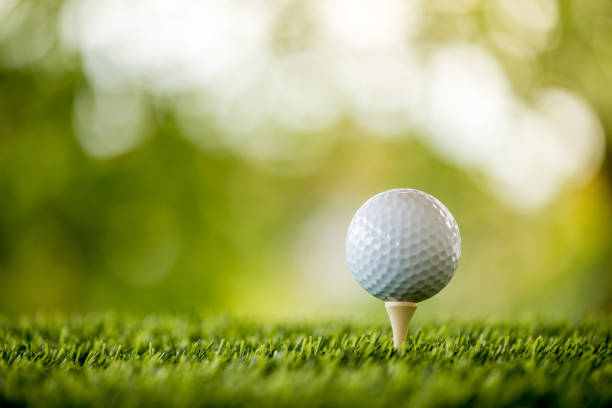 golf ball on tee ready to play - golf stock pictures, royalty-free photos & images