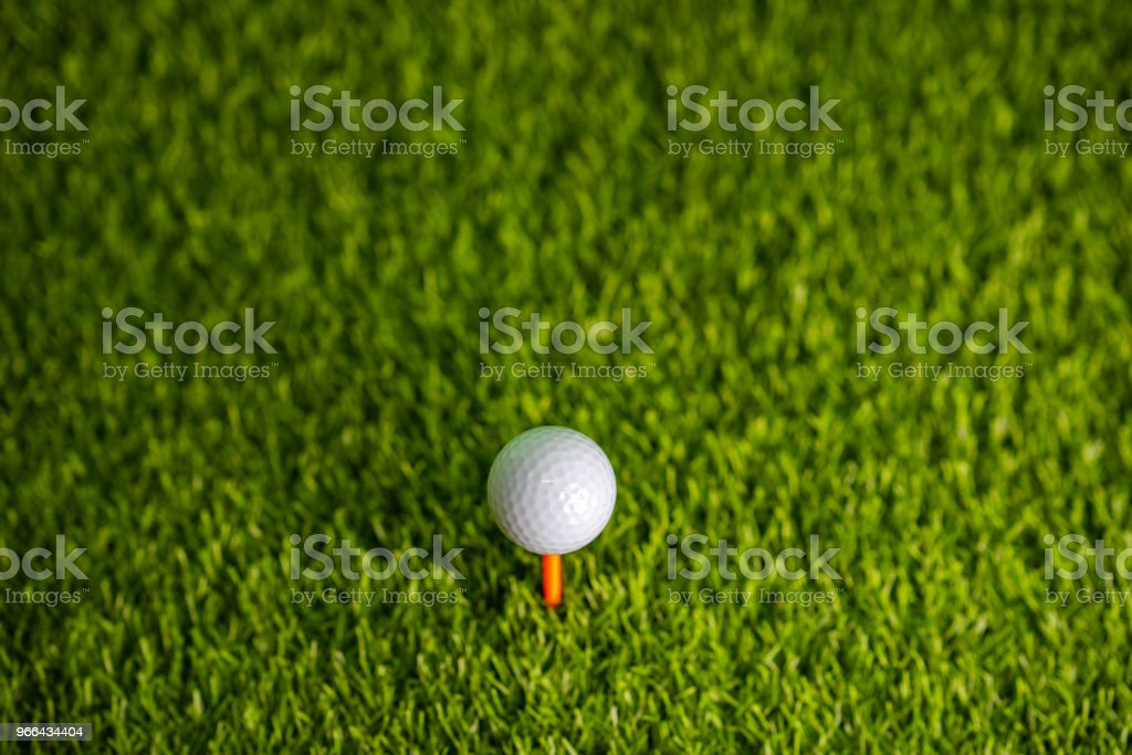 Golf ball on tee sitting for golfer hitting in golf course
