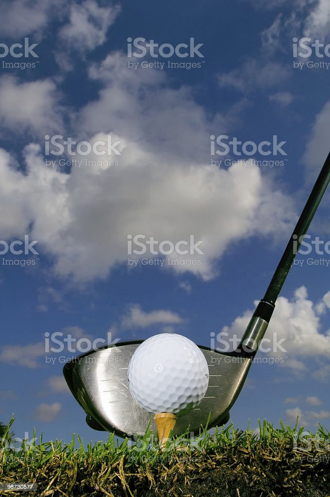 golf ball on tee with driver from ground level royalty-free stock photo
