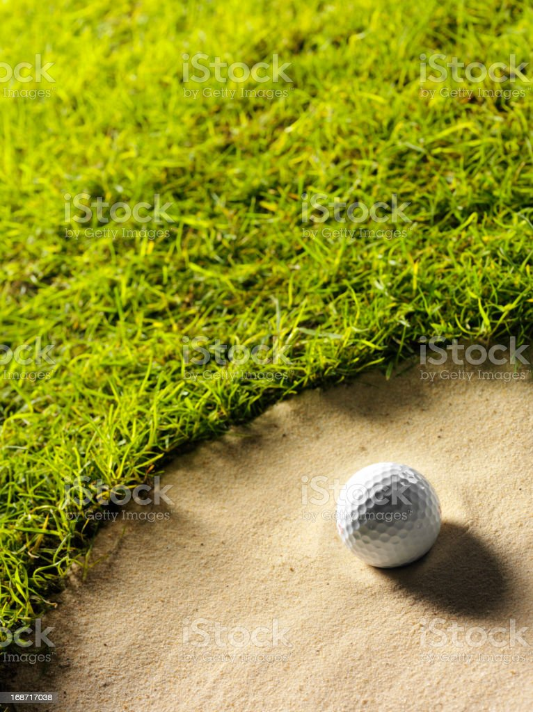 Golf Ball on the Edge of a Bunker stock photo