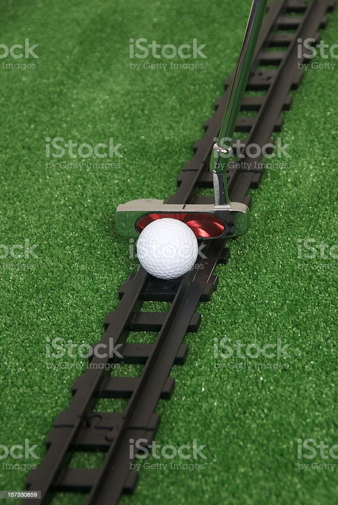Golf ball on track royalty-free stock photo