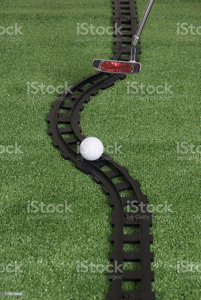 Golf ball on tracks royalty-free stock photo