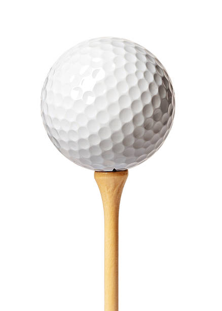 Golf ball Golf ball on a tee isolated on white golf ball stock pictures, royalty-free photos & images