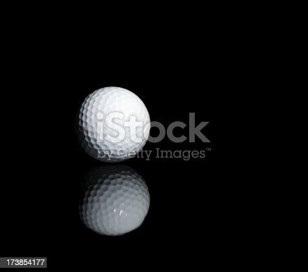 Golf ball at reflective surface