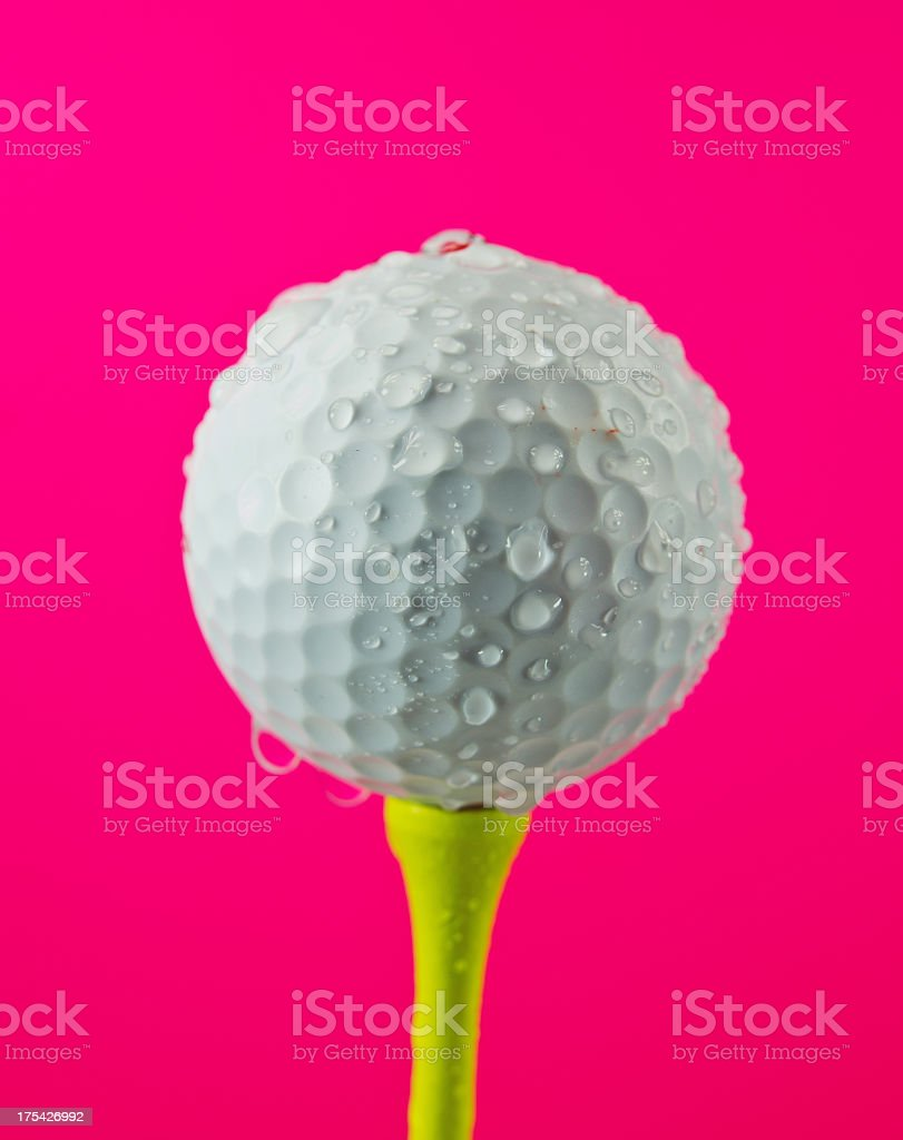 Golf Ball Rained Out  on Brilliant Pink royalty-free stock photo