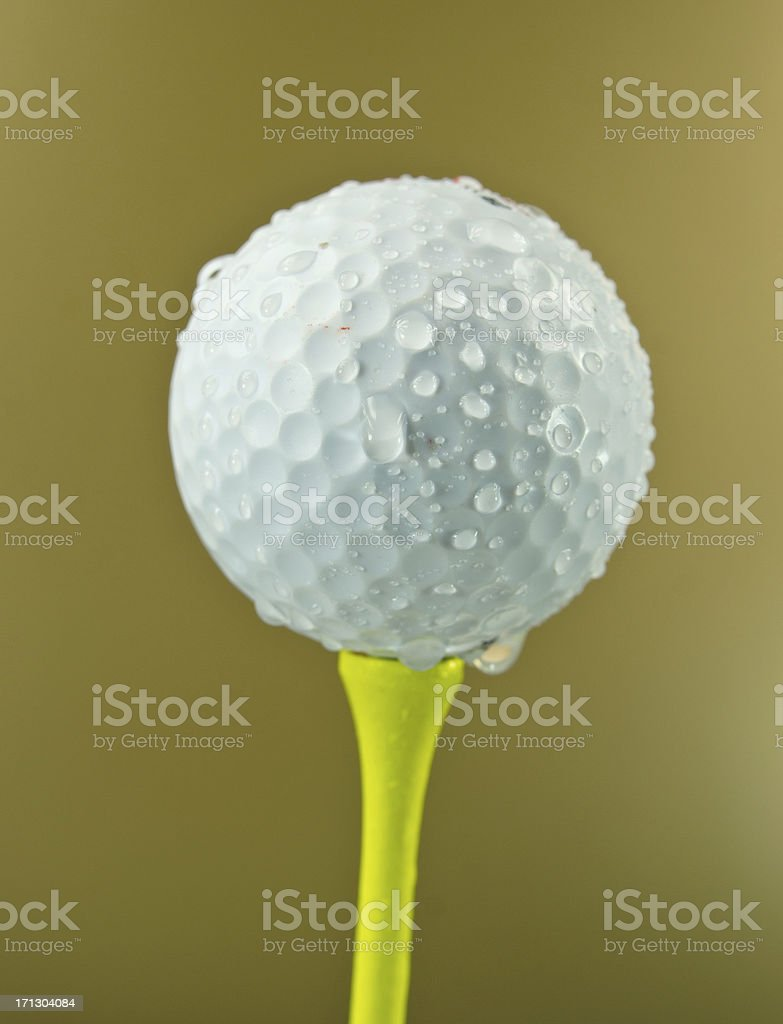 Golf Ball Rained Out  on Dark Yellow royalty-free stock photo