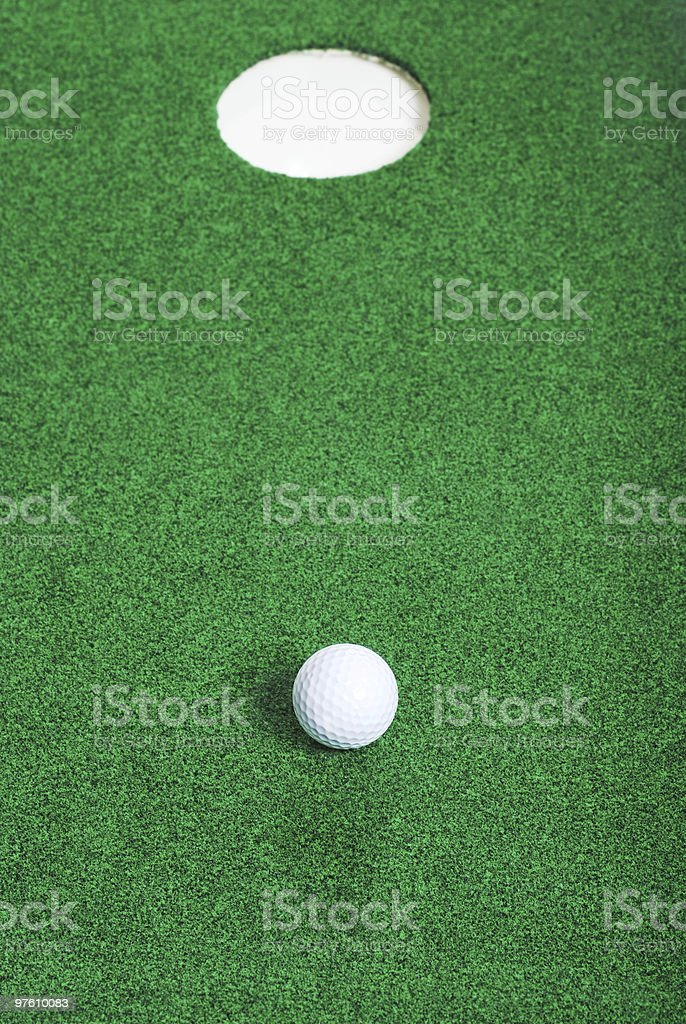 golf ball short of hole royalty-free stock photo