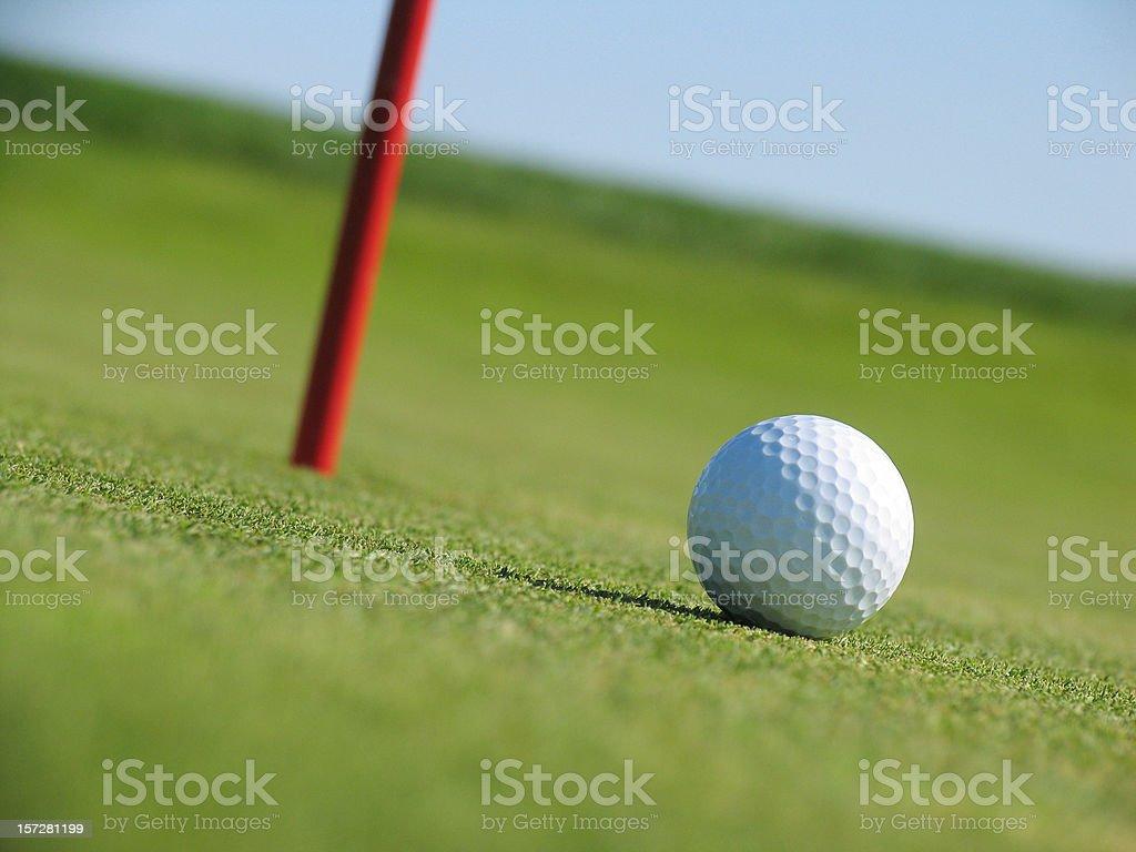 Golf Ball Sitting Next to Hole royalty-free stock photo