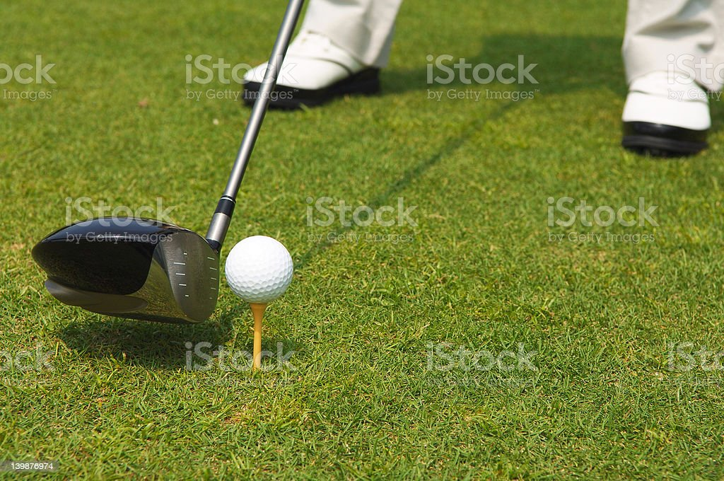 golf ball teed up for hitting with a driver royalty-free stock photo