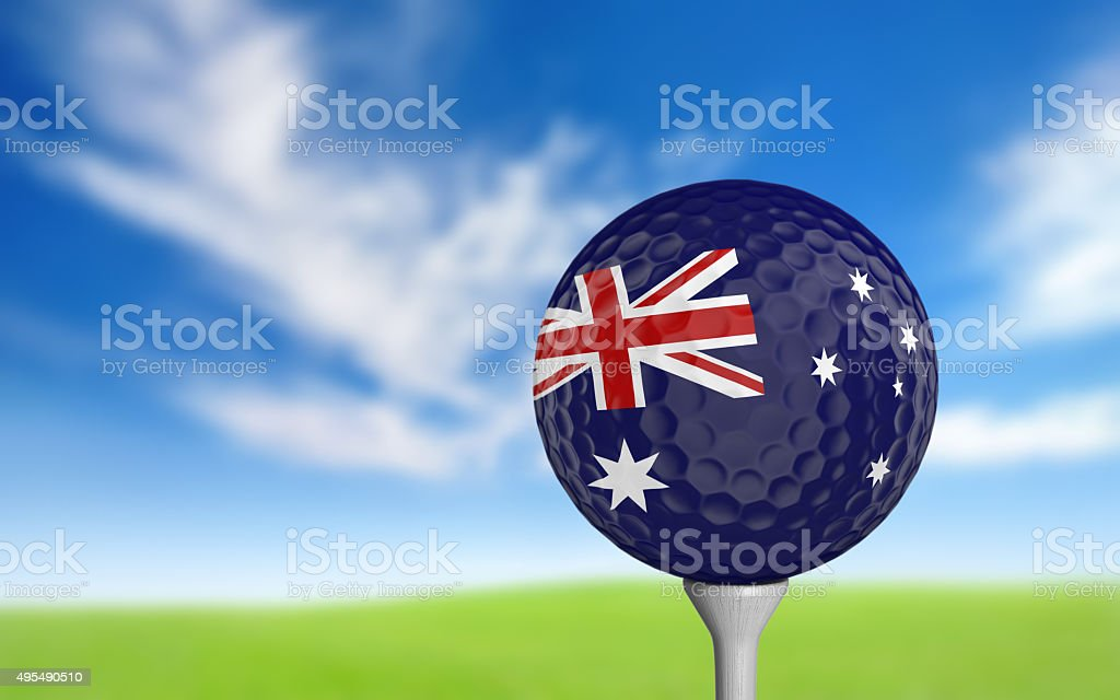 Golf ball with Australia flag colors sitting on a tee stock photo