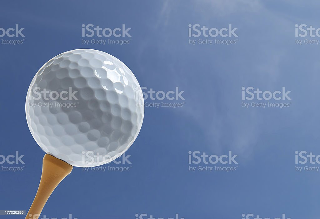 golf ball with blue sky stock photo