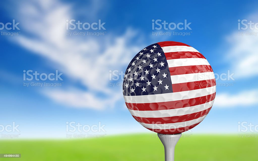 Golf ball with United States flag colors sitting on tee stock photo