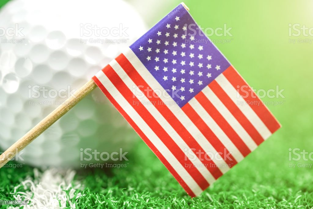 Golf ball with USA flag on green lawn or field : most popular sport...
