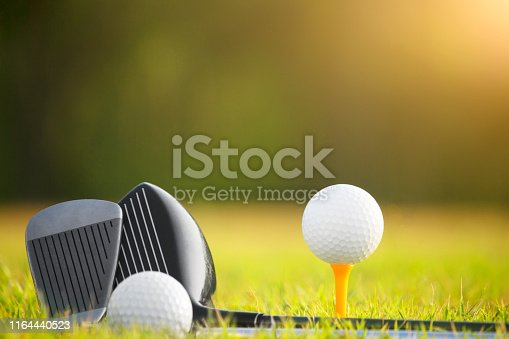 istock Golf balls and golf clubs as well as equipment used to play golf on green grass 1164440523