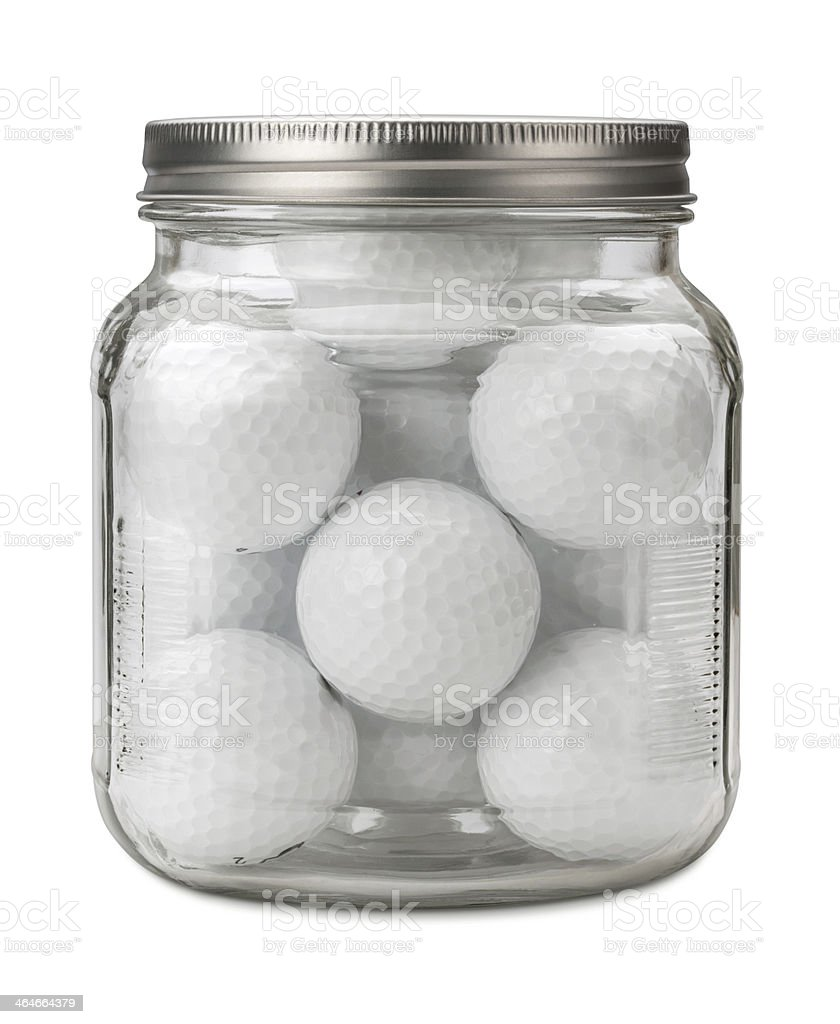 Golf Balls in a Jar with a clipping path stock photo