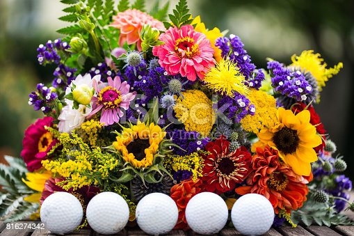 825397576 istock photo golf balls with flowers for birthday, card, voucher 816274342