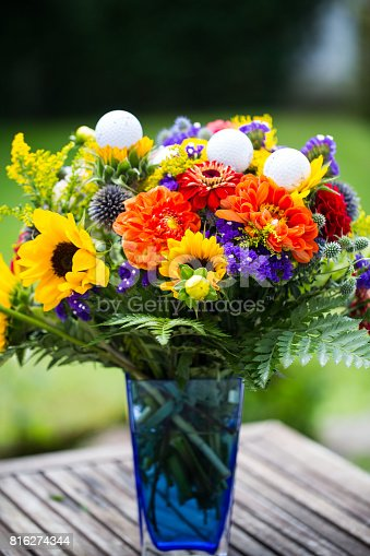 825397576 istock photo golf balls with flowers for birthday, card, voucher 816274344