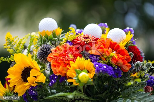 825397576 istock photo golf balls with flowers for birthday, card, voucher 816274348