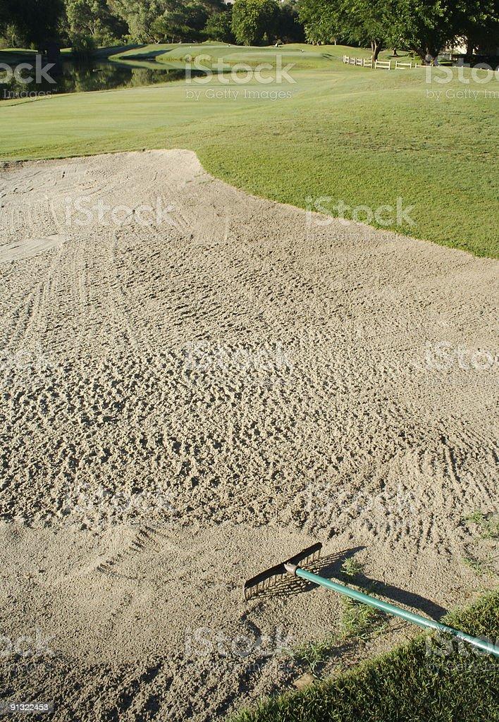 Golf Bunker and Rake stock photo