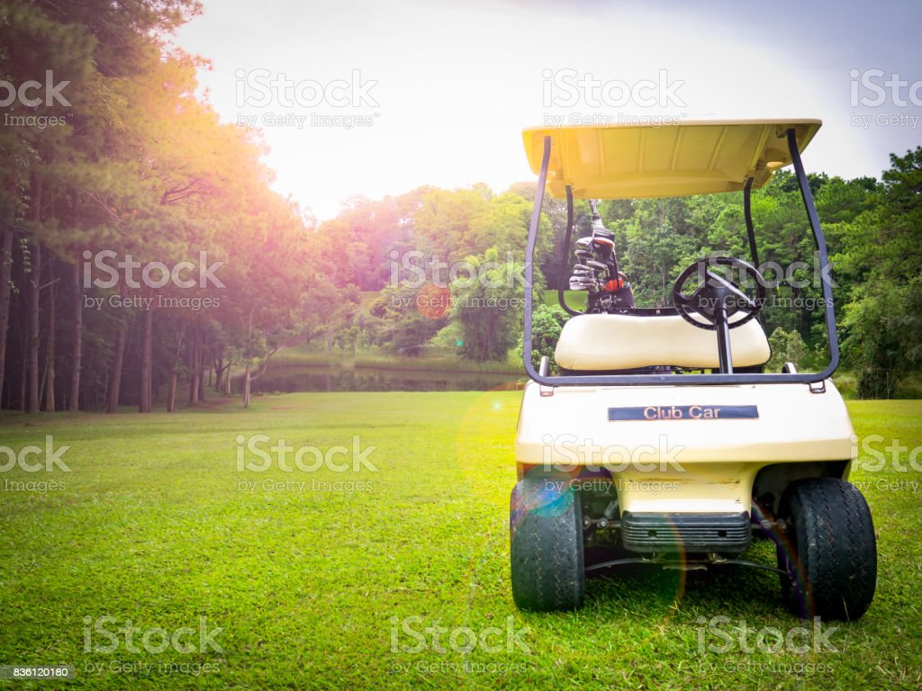 golf car or club car or golf cart on beautiful fairway on layout of golf course stock photo