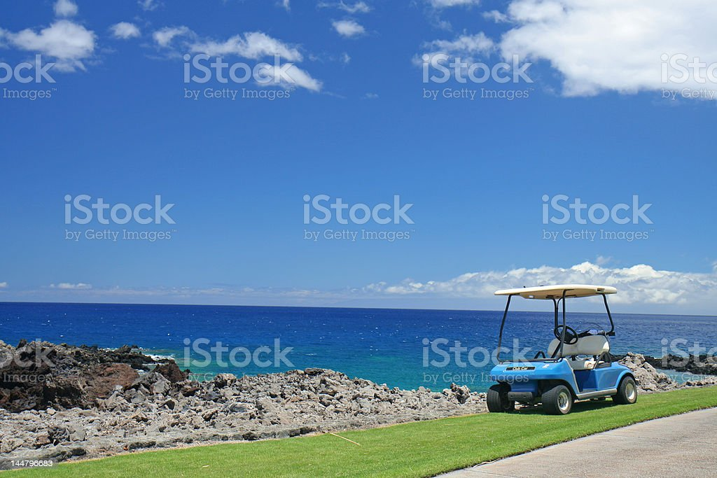 Golf cart at the beach stock photo