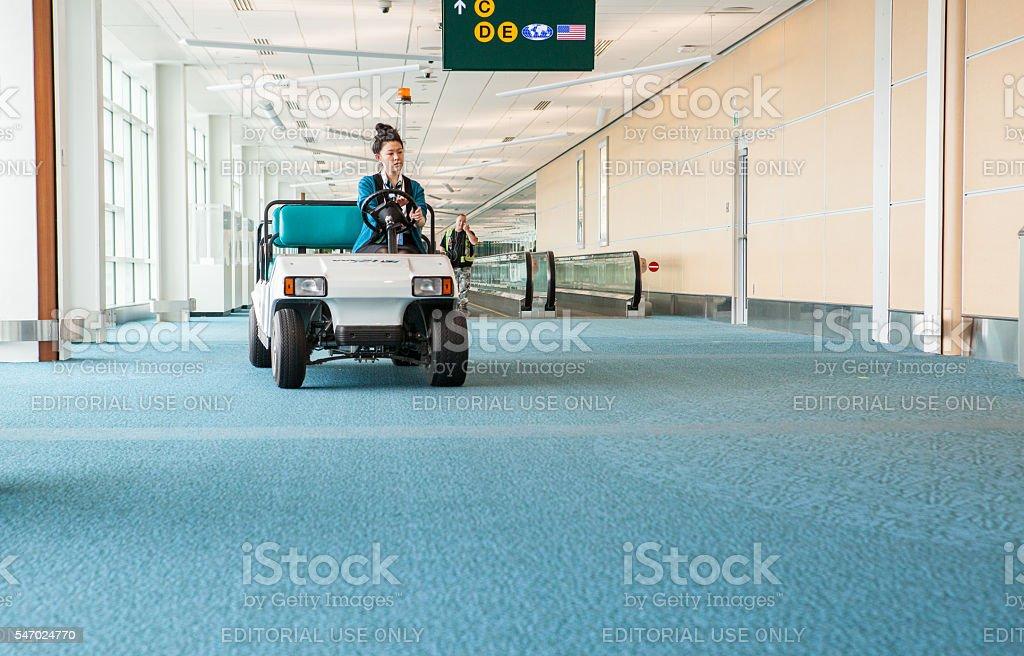 Golf Cart driving though an Airport - Photo