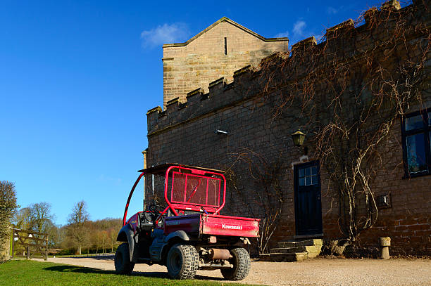 Golf cart in Newstead Abbey grounds Newstead Abbey, Nottinghamshire, England - March 1, 2015: A golf cart in the grounds of Newstead Abbey, Nottinghamshire, England. On 1st March 2015. kawasaki heavy industries stock pictures, royalty-free photos & images