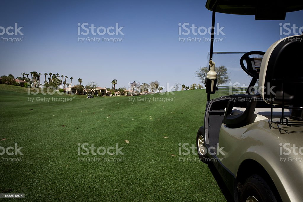 Golf Cart on a Fairway royalty-free stock photo