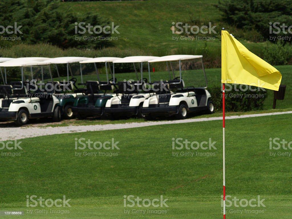 Golf carts and flag royalty-free stock photo