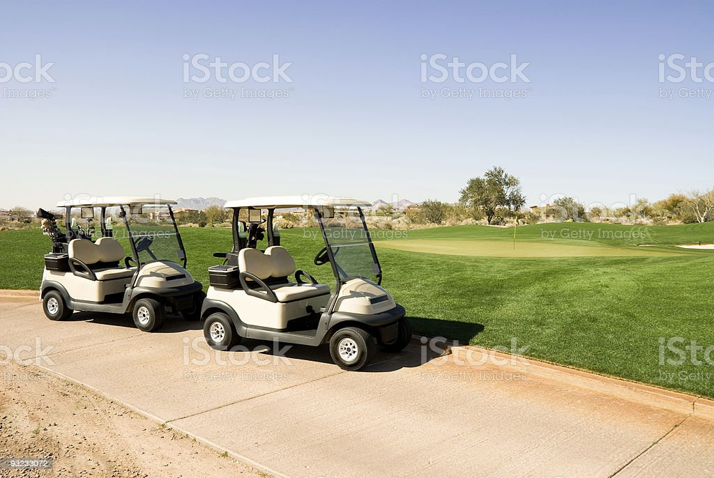 Golf carts on gold course stock photo