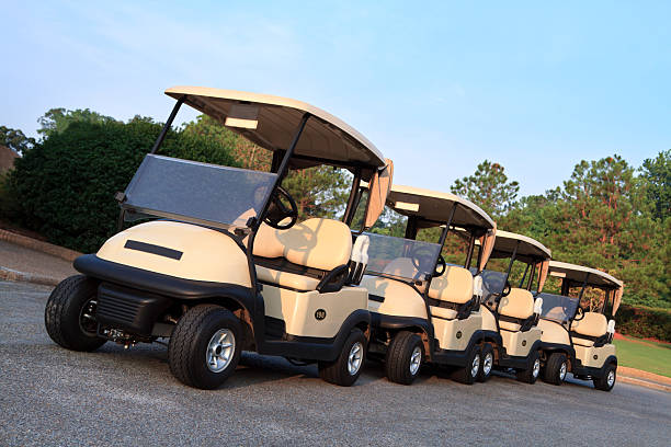 golf carts ready for players - carolinemaryan stock pictures, royalty-free photos & images