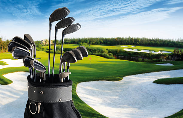 golf club and bag with fairway background - xxlarge - golf clubs stock photos and pictures