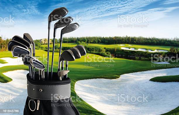 Golf Club And Bag With Fairway Background Xxlarge Stock Photo - Download Image Now