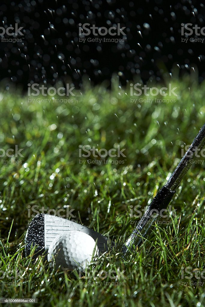 Golf club in motion over grass royalty-free stock photo