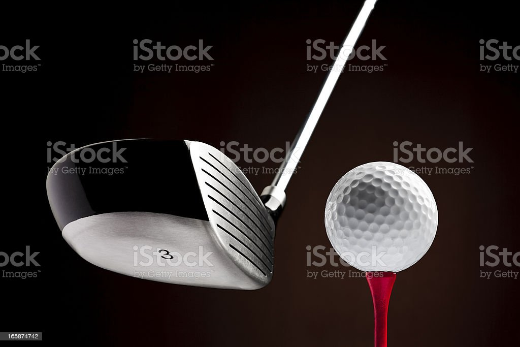 Golf Clubhead hitting a Ball on the Tee stock photo