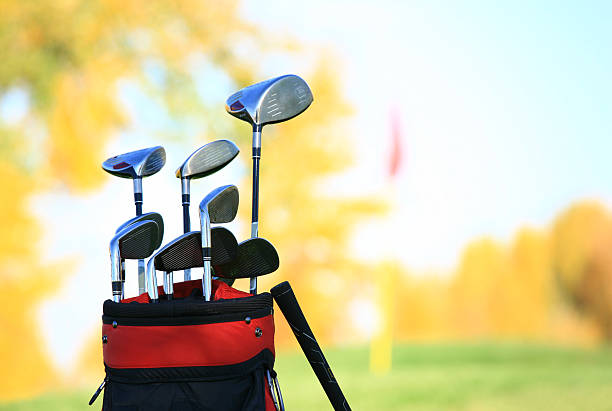 Golf Clubs and Equipment at a Beautiful Fall Course stock photo