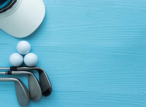 golf clubs, golf balls, cap, on blue wooden table - golf stock photos and pictures
