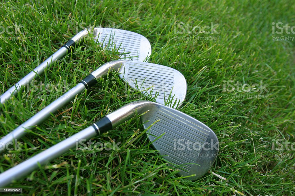 Golf Clubs in Grass royalty-free stock photo