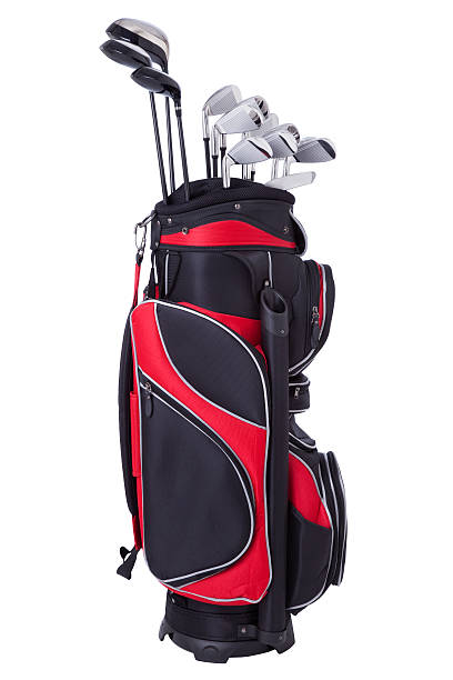 golf clubs in red and black bag isolated on white - golf clubs stock photos and pictures