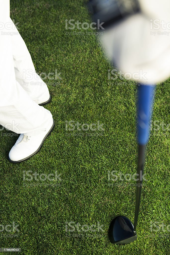 golf clubs in the hand on green backgroud royalty-free stock photo