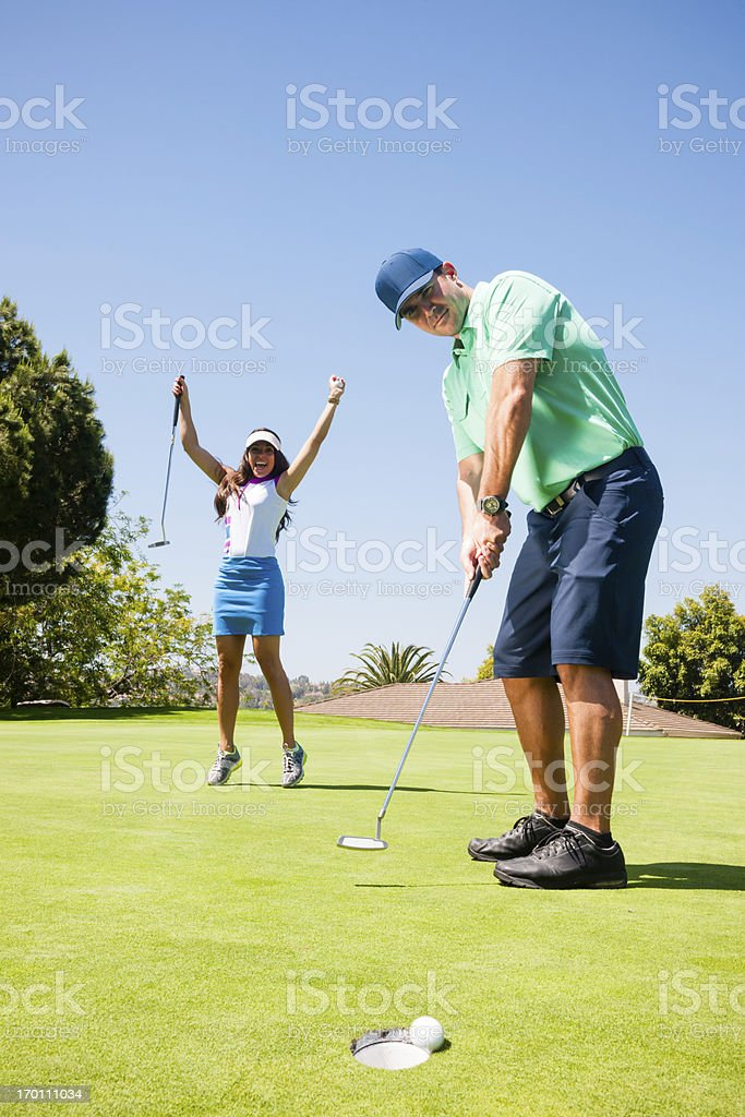 Golf Couple Putting stock photo