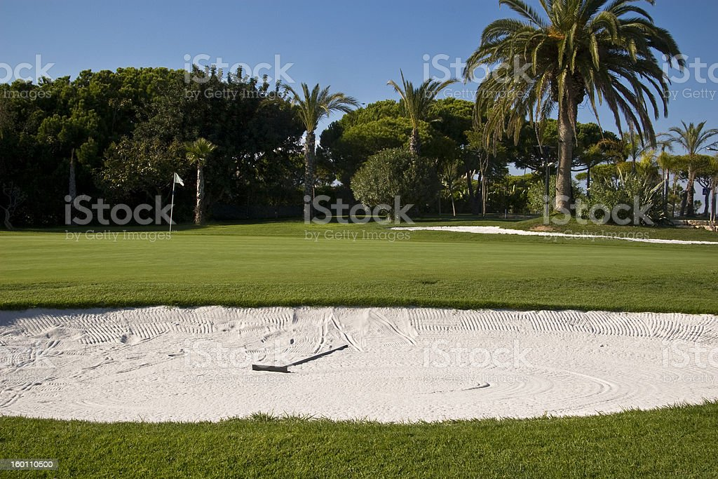 Golf course 16th hole and bunker royalty-free stock photo