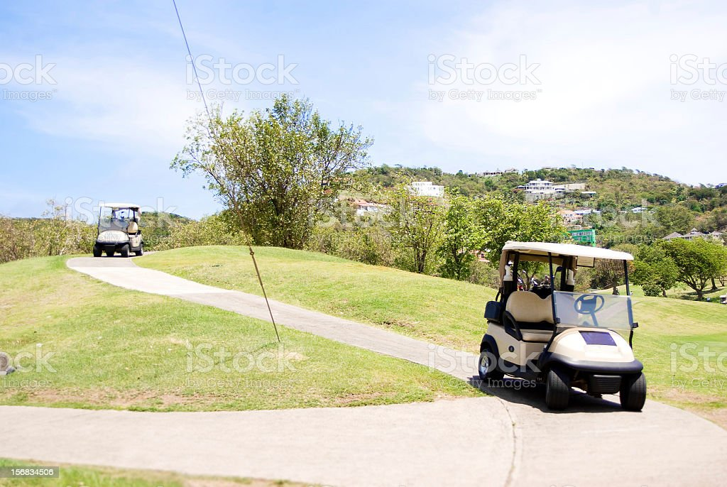 golf course and carts stock photo