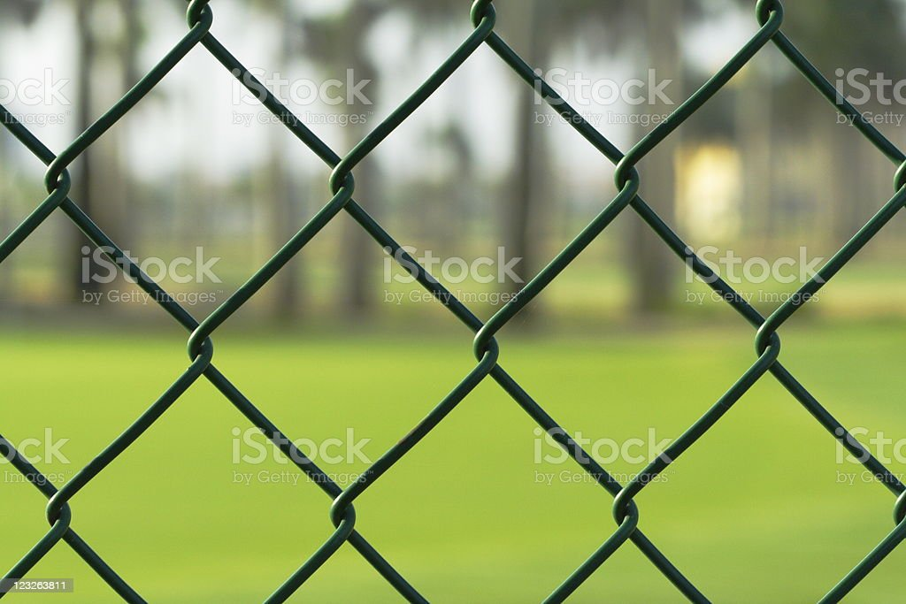 golf course behind a fence royalty-free stock photo